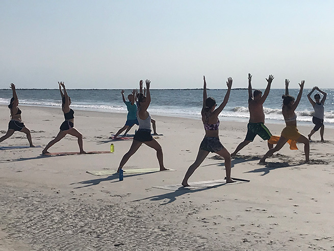 People doing Yoga on Masonboro Island
